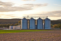 Silos in sunset with beautiful view over acres Royalty Free Stock Images