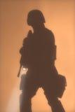 Silouette de dirigeant de COUP dans le brouillard Images stock