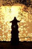 Silouette della lanterna al tramonto Immagine Stock