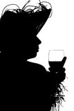 Silouette of a lady. Lady in hat with glass of wine as black silouette on white background Royalty Free Stock Photos