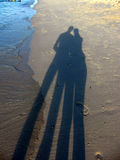 Silouette shadows in the sand Stock Photography