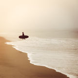 Silouette of Surfer in Fog. Foggy Beach With Surfer Silhouette in Fog Royalty Free Stock Photography