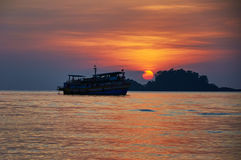Silouette of tourist boat at sunset, Asia Royalty Free Stock Photo