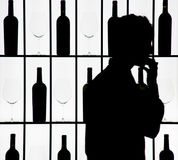Silouette of a waiter against bottle and glasses Stock Photo