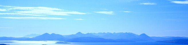 Silouetted mountains. The mountainous Western Isles off the coast of Scotland Stock Images