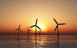 Silouettes de los molinoes de viento Fotografía de archivo libre de regalías