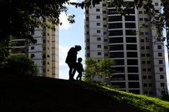 Silouhette μητέρων και παιδιών Στοκ Εικόνες