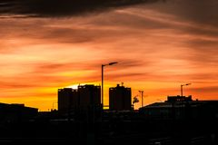 Silouhette of Glasgow High rise flats at sunset stock photography