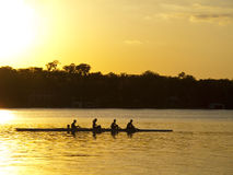 Silouhetted Rowing team Stock Photos