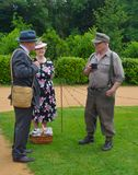 Two Men and a Woman Dressed in  in Second World War Clothes and Uniform. SILSOE, BEDFORDSHIRE, ENGLAND - MAY 28, 2017:  Two Men and a Woman Dressed in  in Stock Photo