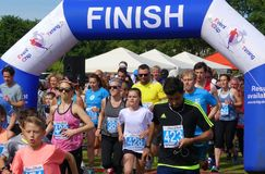 Silsoe, England - June 24 2018 - Runners set off on the annual Silsoe Stride run, passing through the start-finish arch stock photography