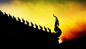 Siluate sunset time King Of Nagas buddhist temple Stock Images