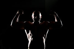 Siluet Muscular Man Flexing Muscles Royalty Free Stock Photo