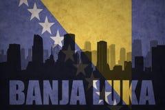 Silueta abstracta de la ciudad con el texto Banja Luka en la bandera del bosníaco del vintage Foto de archivo libre de regalías