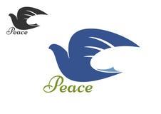 Silueta azul de la paloma como símbolo de la paz Imagenes de archivo