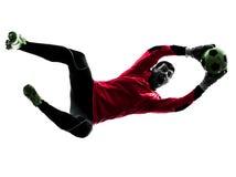 Silueta de cogida de la bola del jugador de fútbol del hombre caucásico del portero Foto de archivo libre de regalías
