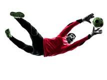 Silueta de cogida de la bola del portero del jugador de fútbol Foto de archivo