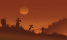 Silueta de Halloween de los cementerios de los bakcgrounds de Brown Imagenes de archivo