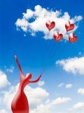 Silueta de la bailarina con el corazón de los globos Fotos de archivo
