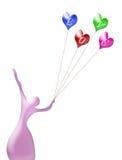 Silueta de la bailarina con el corazón multicolor de los globos del aire Foto de archivo libre de regalías