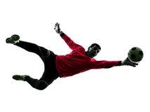 Silueta de la bola de la captura del hombre del portero del jugador de fútbol Fotografía de archivo libre de regalías