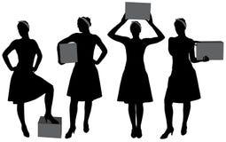 Silueta de la caja de la mujer que lleva Imagen de archivo libre de regalías