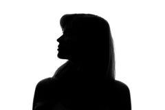silueta de la cara de una mujer en un fondo blanco Foto de archivo
