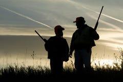 Silueta de la caza Fotografía de archivo libre de regalías