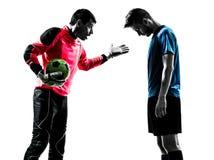 Silueta de la competencia del portero del jugador de fútbol Fotos de archivo libres de regalías