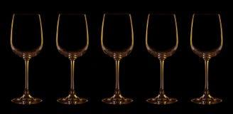Silueta de la copa con la iluminación amarilla y marrón Imagenes de archivo