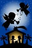 Silueta de la escena de la natividad de la Navidad con ángeles Fotos de archivo libres de regalías
