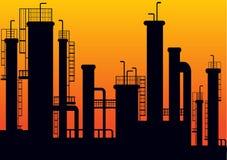 Silueta de la fábrica en puesta del sol Imagen de archivo libre de regalías