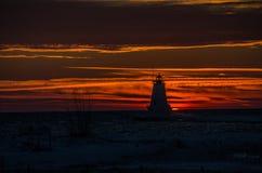 Silueta de la luz de Ludington en la puesta del sol Imagen de archivo
