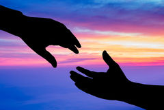 silueta de la mano amiga Imagen de archivo