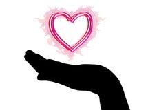 Silueta de la mano con el corazón Fotos de archivo