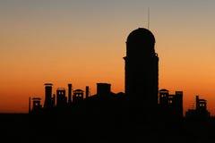 Silueta de la mezquita en la puesta del sol Fotografía de archivo libre de regalías