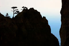 Silueta de la montaña de la roca Fotografía de archivo libre de regalías