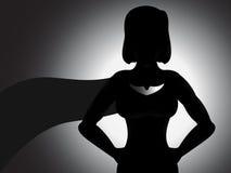 Silueta de la muchacha del super héroe Fotografía de archivo libre de regalías
