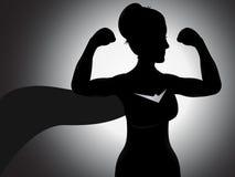 Silueta de la muchacha del super héroe Imagenes de archivo