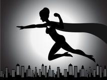 Silueta de la muchacha del super héroe del vuelo Imágenes de archivo libres de regalías