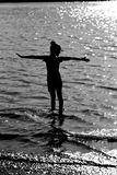 Silueta de la muchacha feliz Fotografía de archivo libre de regalías
