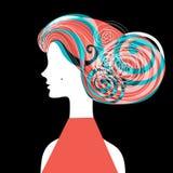 Silueta de la mujer con el pelo rizado Foto de archivo