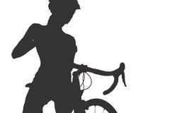 Silueta de la mujer con una bicicleta Fotos de archivo libres de regalías