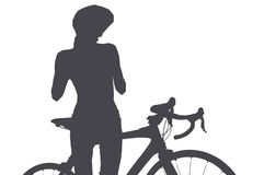 Silueta de la mujer con una bicicleta Imagen de archivo libre de regalías