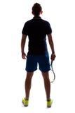Silueta de la parte posterior del jugador de tenis imagenes de archivo