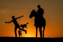 Silueta de la puesta del sol Foto de archivo libre de regalías