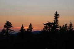 Silueta de la puesta del sol Imagen de archivo libre de regalías