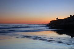 Silueta de la puesta del sol Imágenes de archivo libres de regalías