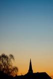 Silueta de la puesta del sol Fotos de archivo