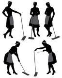 Silueta de la señora de la limpieza Imagenes de archivo
